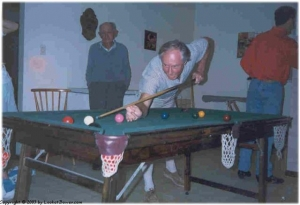Dad playing snooker with the old boy.