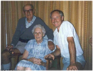 Grandpa and Granny on their 50th wedding anniversary with Dad.